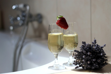 Luxury, relaxing, romantic bath with champagne and strawberries photo