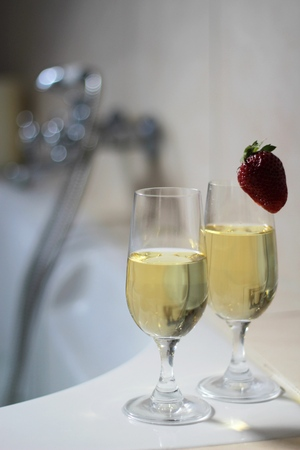 Bath for two with champagne and strawberries photo