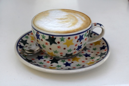 Coffee in a cup from polish traditional pottery from Boleslawiec   Bunzlau photo