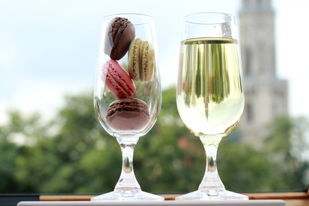 Two glasses of French macarons and white wine - the perfect recipe for a date photo