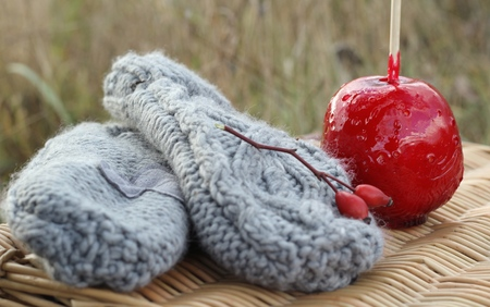 candy apple: gloves and candy apple Stock Photo