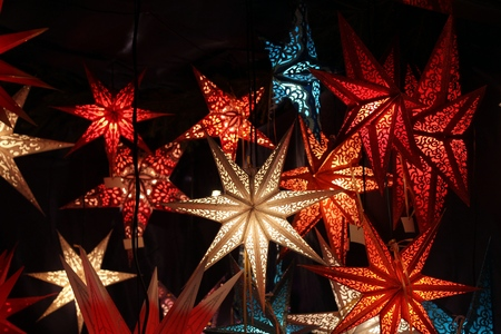 Paper christmas stars on a dark background photo