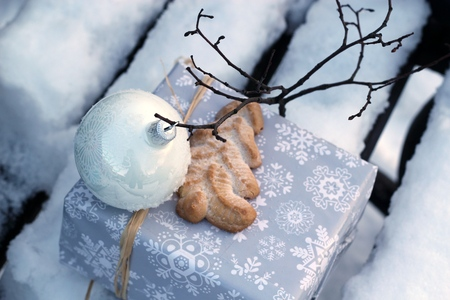 gift on snow covered bench photo
