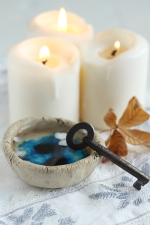 divination: tradition polish wax candle divination on evening predictions on the eve of St. Andrew Stock Photo