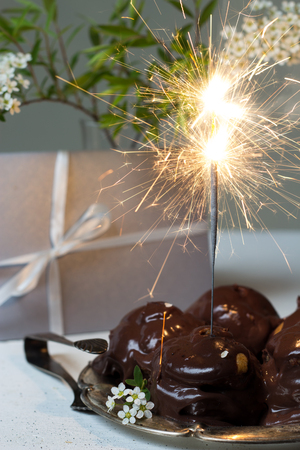 puffs: gift, cream puffs and sparklers Stock Photo