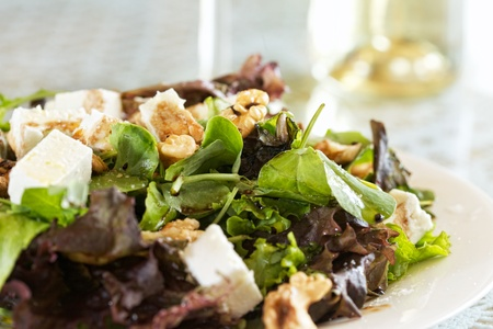 Delicious Feta and Walnut Salad with fresh leaves  photo