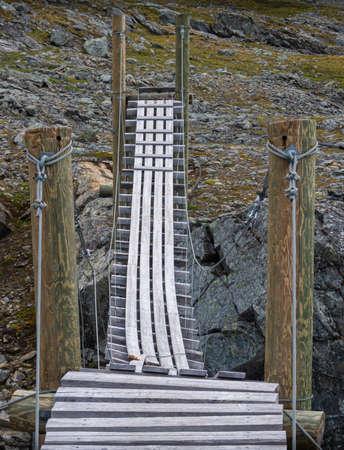Wooden hiking bridge over a river on the Nordkalottleden in Norway Stock fotó