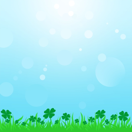 irish landscape: Summer landscape with green grass with clover leaf with a blue sky with the sun and sun reflections