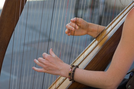 Closeup of a Woman playing Harp photo