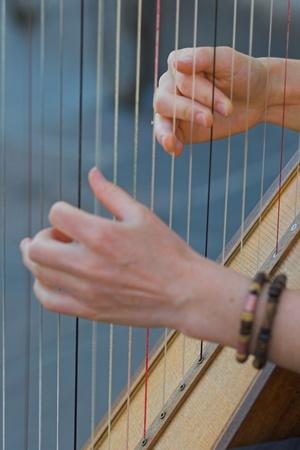 harp: Closeup of a Woman playing Harp Stock Photo