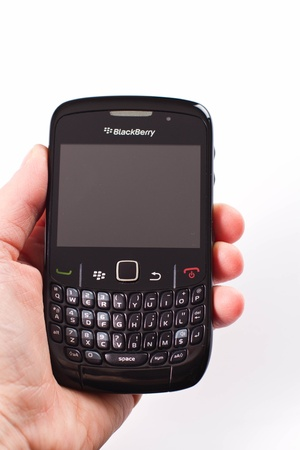 holding a blackberry phone