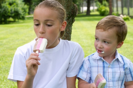 Kids eating Ice Cream photo