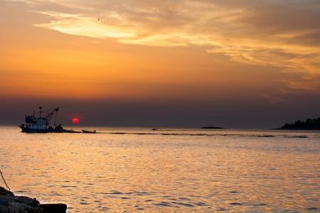 shrimp boat: Fishing Boat at Sunset