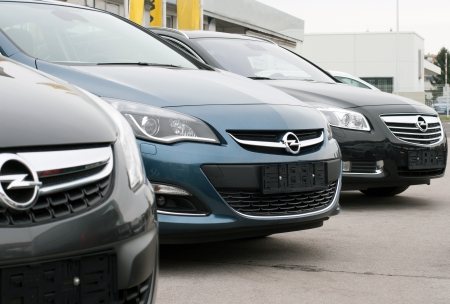 Row of new Opel cars at dealership