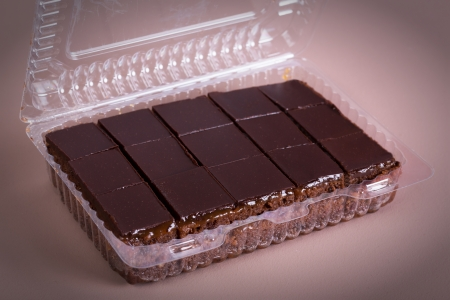 Chocolate cake in box isolated photo