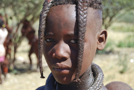 KAOKOLAND NAMIBIA - MAY 4: Unidentified child near Opuwo on May 4, 2008, Namibia. Himbas are the last Nomadic People in Namibia - there are only about 7000 left