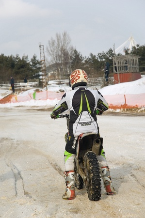 MOSCOW - FEBRUARY 28: Unrecognised sportsman on a second tour of motocross of Red Racing Group club on February 28, 2010 in Moscow, Krilatskoe, Russia Stock Photo - 9073806