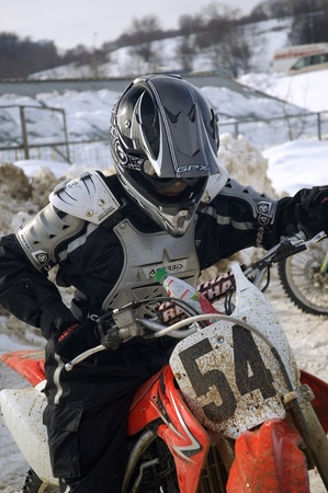 MOSCOW - FEBRUARY 28: Unrecognised sportsman on a second tour of motocross of Red Racing Group club on February 28, 2010 in Moscow, Krilatskoe, Russia Stock Photo - 9073805