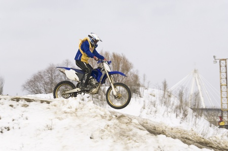 MOSCOW - FEBRUARY 28: Unrecognised sportsman on a second tour of motocross of Red Racing Group club on February 28, 2010 in Moscow, Krilatskoe, Russia Stock Photo - 9073796