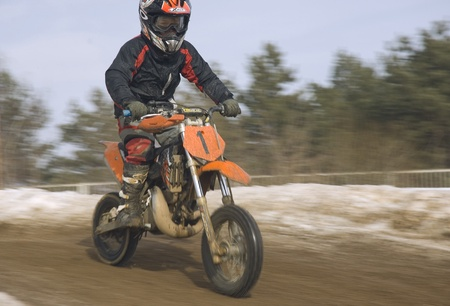 MOSCOW - FEBRUARY 28: Unrecognised sportsman on a second tour of motocross of Red Racing Group club on February 28, 2010 in Moscow, Krilatskoe, Russia Stock Photo - 9073803