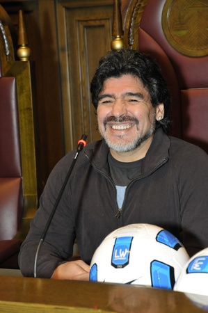 MOSCOW - SEPTEMBER 30: Footballer Diego Maradona at a friendly meeting on September, 30, 2010 in the Supreme Court of the Russian Federation, Moscow, Russia  Editorial