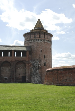 Partly reconstructed brick wall and tower of old fortress in Kolomna town near Moscow, Russia