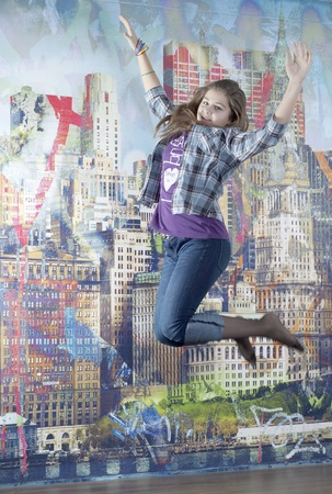 Young girl jump up photo