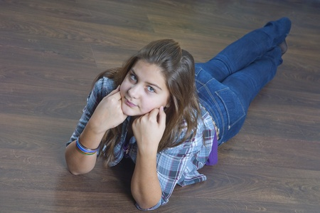 Young girl on a floor photo