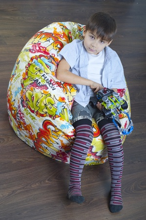 nurser: Young boy with a toy Stock Photo