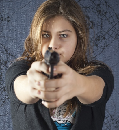 Girl with a weapon on abstract background photo