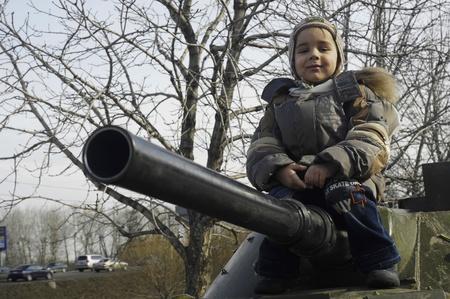 Kid on a tank Stock Photo - 12064480