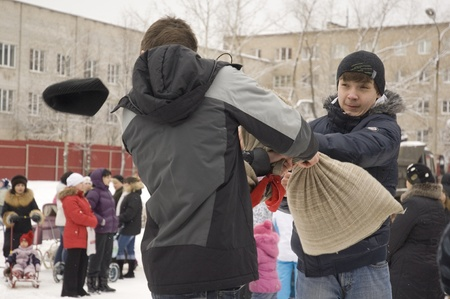 sudarium: PODOLSK, RUSSIA - FEB 25: Unidentified people celebrating Russian religious and folk holiday Maslenitsa on schoolyard in Podolsk city on February 26, 2012, Russia
