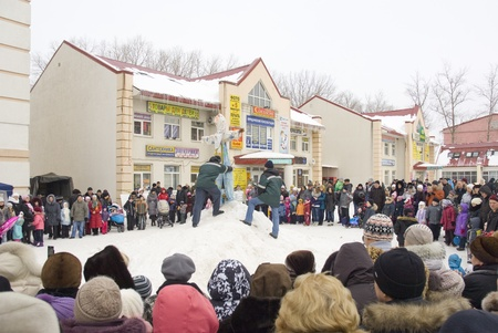 maslenitsa: PODOLSK, RUSSIA - FEB 26: Unidentified people prepare to fire the Maslenitsa Doll on  Russian holiday Maslenitsa on a square in Podolsk city on February 26, 2012, Russia