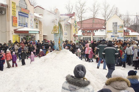 PODOLSK, RUSSIA - FEB 26: Unidentified people is fire the Maslenitsa Doll on  Russian holiday Maslenitsa on a square in Podolsk city on February 26, 2012, Russia