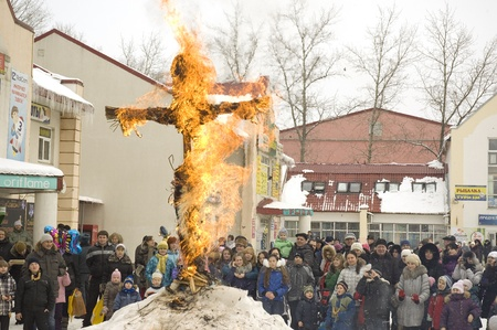 sudarium: PODOLSK, RUSSIA - FEB 26: Unidentified people is fire the Maslenitsa Doll on  Russian holiday Maslenitsa on a square in Podolsk city on February 26, 2012, Russia