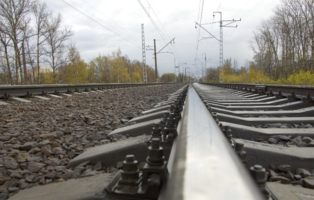 disuse: Train track covered with fallen leaves in autumn