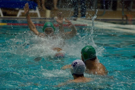 MOSCOW - APRIL  6  Unidentified player during a game Dynamo white  vs Sintez  green  of waterpolo Championship of Russia on April 6, 2012 Moscow, Russia  Sintez won 13 10 Stock Photo - 13072510