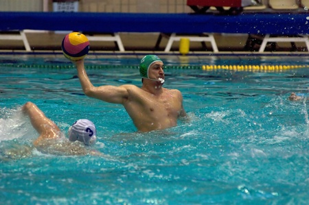 waterpolo: MOSCOW - APRIL  6  Unidentified player during a game Dynamo white  vs Sintez  green  of waterpolo Championship of Russia on April 6, 2012 Moscow, Russia  Sintez won 13 10