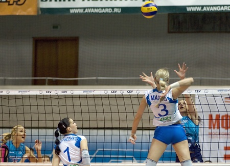 MOSCOW, RUSSIA - APRIL 12   M Borisenko  W,1 , L  Makhno W,3 , E  Yaneva B,5 , J  Morozova B,1  on women s Rissian volleyball Championship game Dynamo MSC   vs Dynamo KZN  on April 12, 2012 in Moscow, Russia
