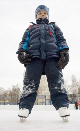 Little boy is stand forward and relux  He tired to play on skates Stock Photo - 13561866
