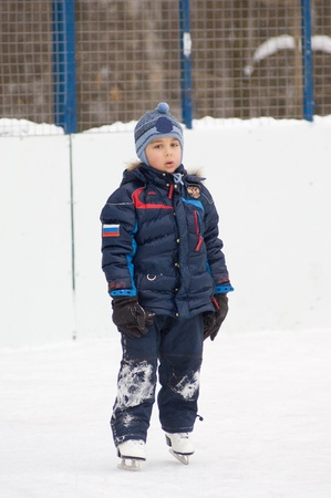 Little boy is stand forward and relux  He tired to play on skates photo