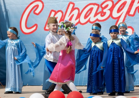 PODOLSK - MAY 9: Unidentified artists of ensemble of choreography Eroshki dancing at event dedicated to Victory Day in WWII on May 9, 2012 in Podolsk, Russia Editorial