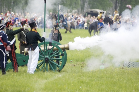 MOSCOW REGION, RUSSIA - MAY 27  Unidentified Soldiers shutting by cannon during 200 unniversary re-enactment of the Borodino battle between Russian and French armies in 1812  May 27, 2012 in Borodino, Russia