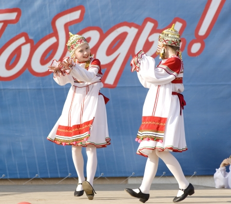 PODOLSK - MAY 9  Unidentified artists of ensemble of culture dance Voronegh dancing at event dedicated to Victory Day in WWII on May 9, 2012 in Podolsk, Russia photo