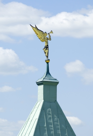 Angel statue blowing hornon a tower of wall of Optin Hermitage photo