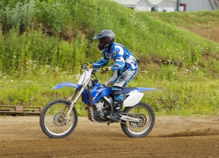 MOSCOW - JUNE 24  P Silaev on a clubs tournament of motocross competition of Red Racing Group club on June 24, 2012 in Moscow, Krilatskoe, Russia
