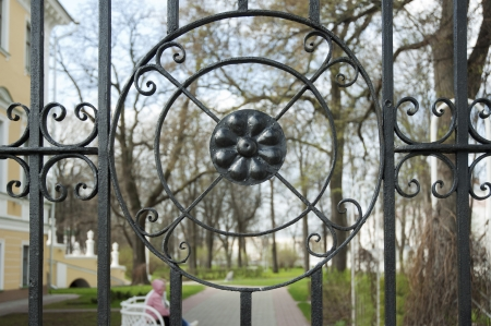 Black metal round residential fence  People in park on the background Stock Photo - 16599003