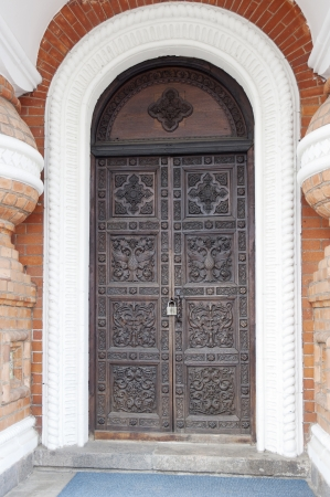 Door of a church with ornament  Entrance to old church Stock Photo