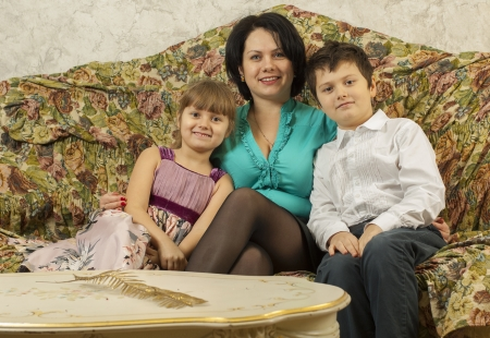 troll dolls: Mother and two kids on the sofa Stock Photo