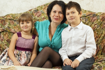 troll dolls: Woman and two children in studio Stock Photo